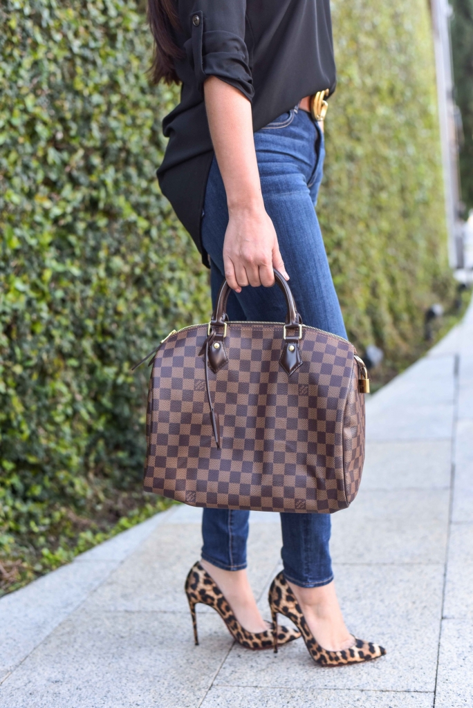 Luxury Handbag Collection and Review featured by top US fashion blog, LuxMommy: image of a woman wearing a louis vuitton speedy 30 ebene