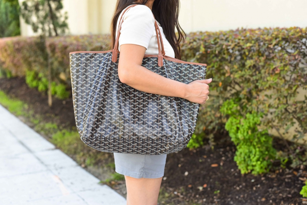 Luxury Handbag Collection and Review featured by top US fashion blog, LuxMommy: image of a woman wearing a goyard st louis gm
