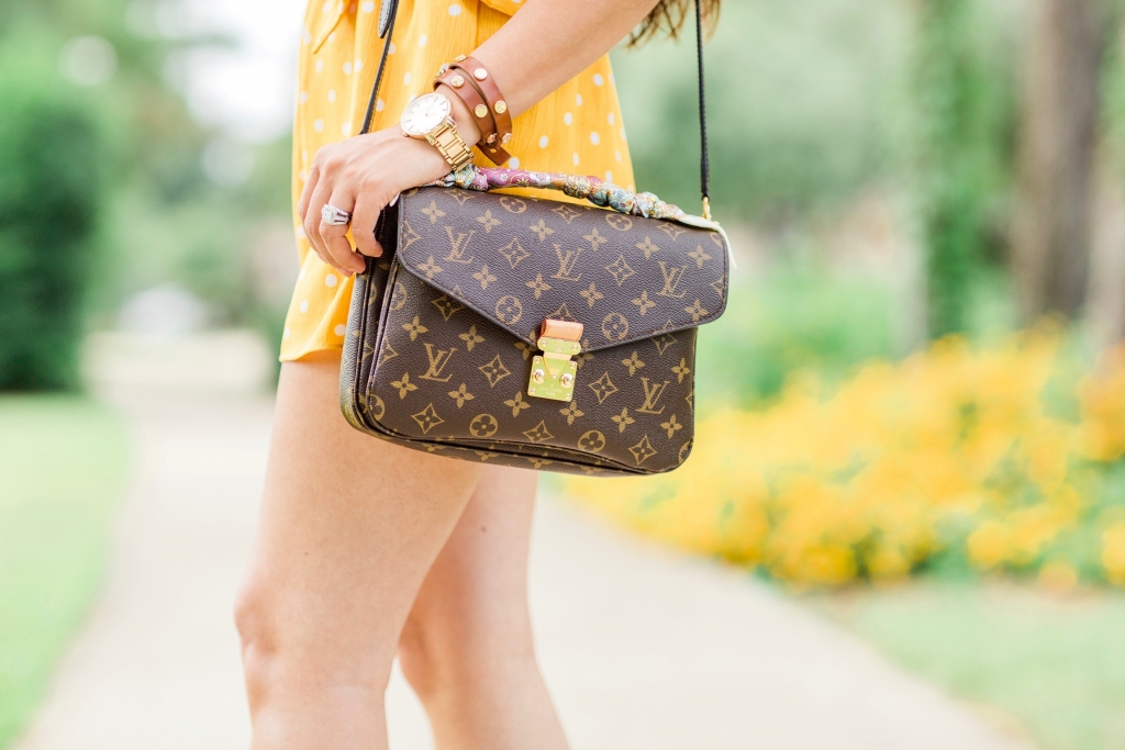 Luxury Handbag Collection and Review featured by top US fashion blog, LuxMommy: image of a woman wearing a louis vuitton pochette metis