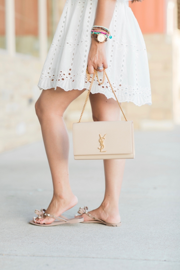 Luxury Handbag Collection and Review featured by top US fashion blog, LuxMommy: image of a woman wearing a YSL Kate medium