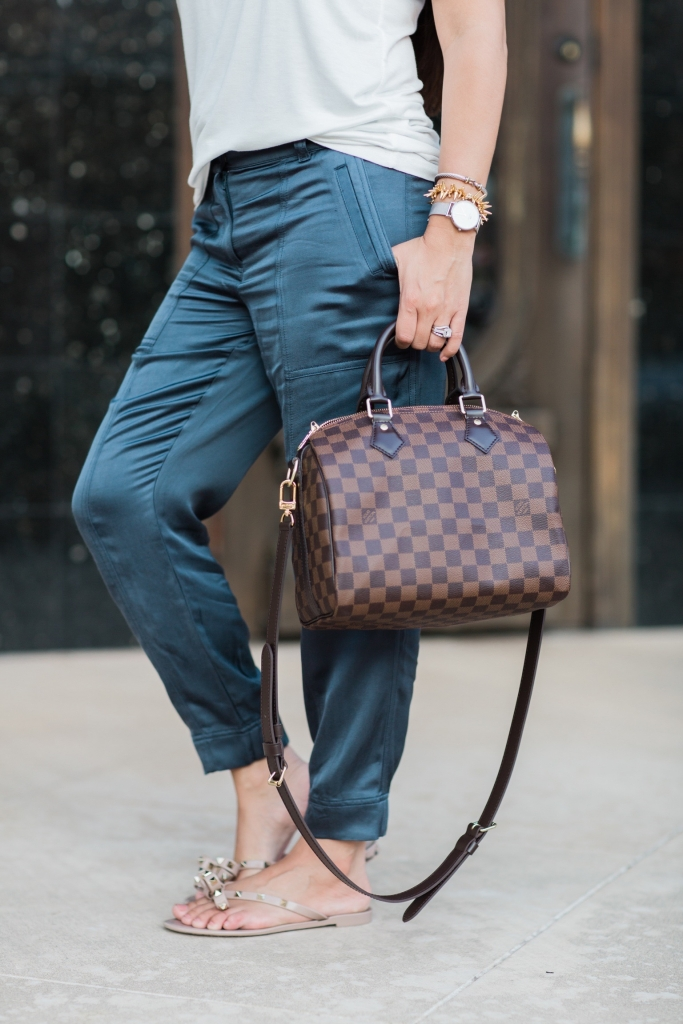 Luxury Handbag Collection and Review featured by top US fashion blog, LuxMommy: image of a woman wearing a louis vuitton speedy B 25 ebene