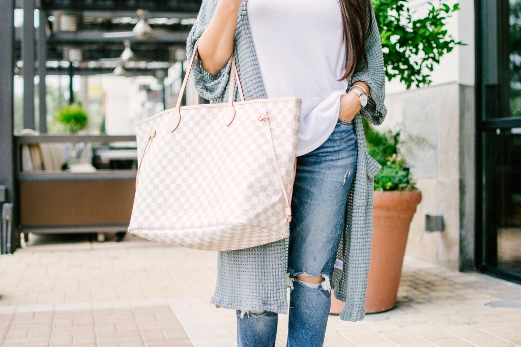 Luxury Handbag Collection and Review featured by top US fashion blog, LuxMommy: image of a woman wearing a louis vuitton neverfull gm azur
