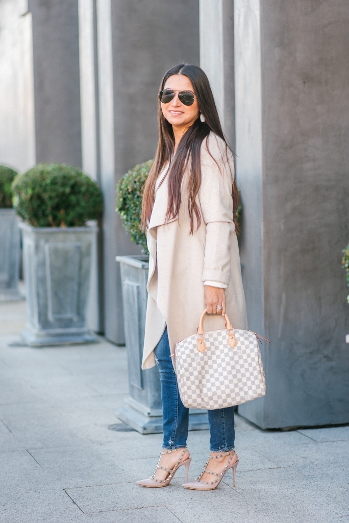 Luxury Handbag Collection and Review featured by top US fashion blog, LuxMommy: image of a woman wearing a louis vuitton speedy 30 azur