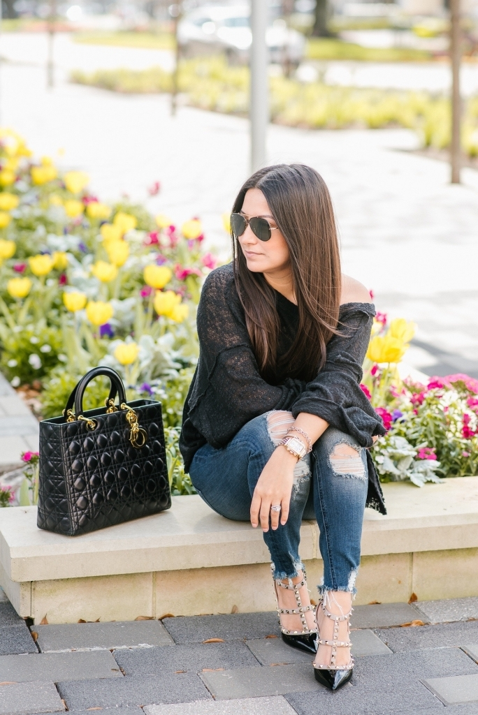 Luxury Handbag Collection and Review featured by top US fashion blog, LuxMommy: image of a woman wearing a Dior Lady Dior