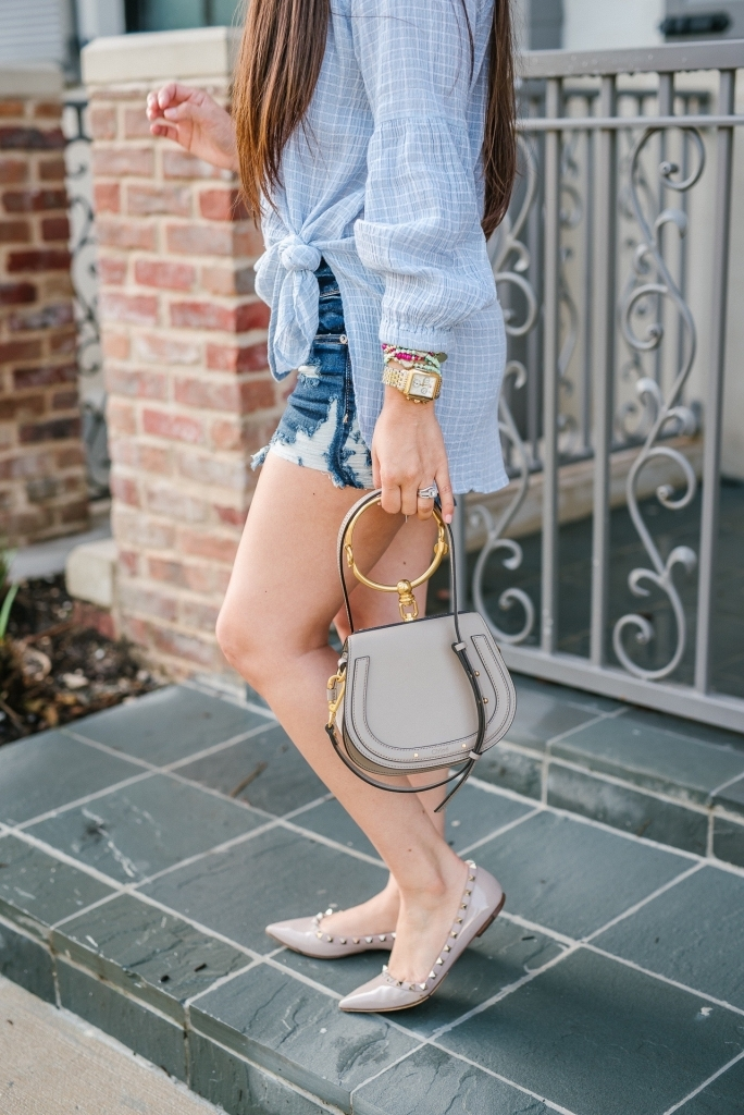 Luxury Handbag Collection and Review featured by top US fashion blog, LuxMommy: image of a woman wearing a Chloe Nile Small