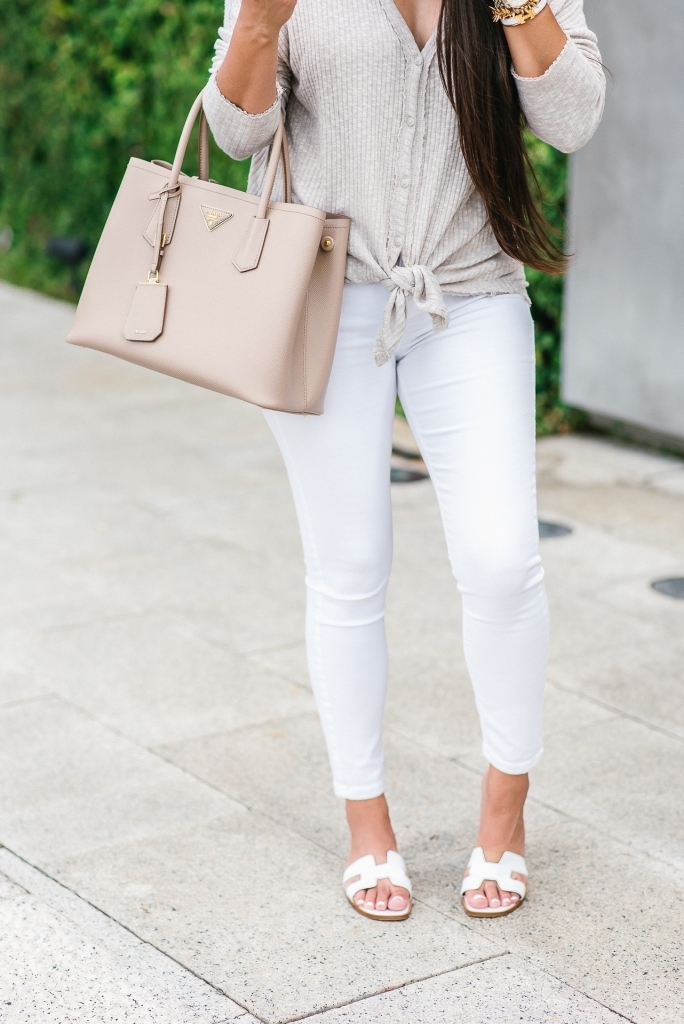 Luxury Handbag Collection and Review featured by top US fashion blog, LuxMommy: image of a woman wearing a Prada Cuir Small