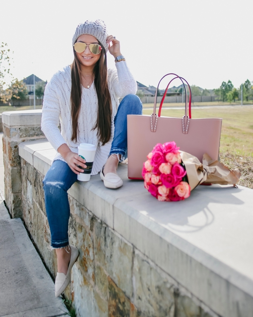 Luxury Handbag Collection and Review featured by top US fashion blog, LuxMommy: image of a woman wearing a Louis Vuitton Cabata tote