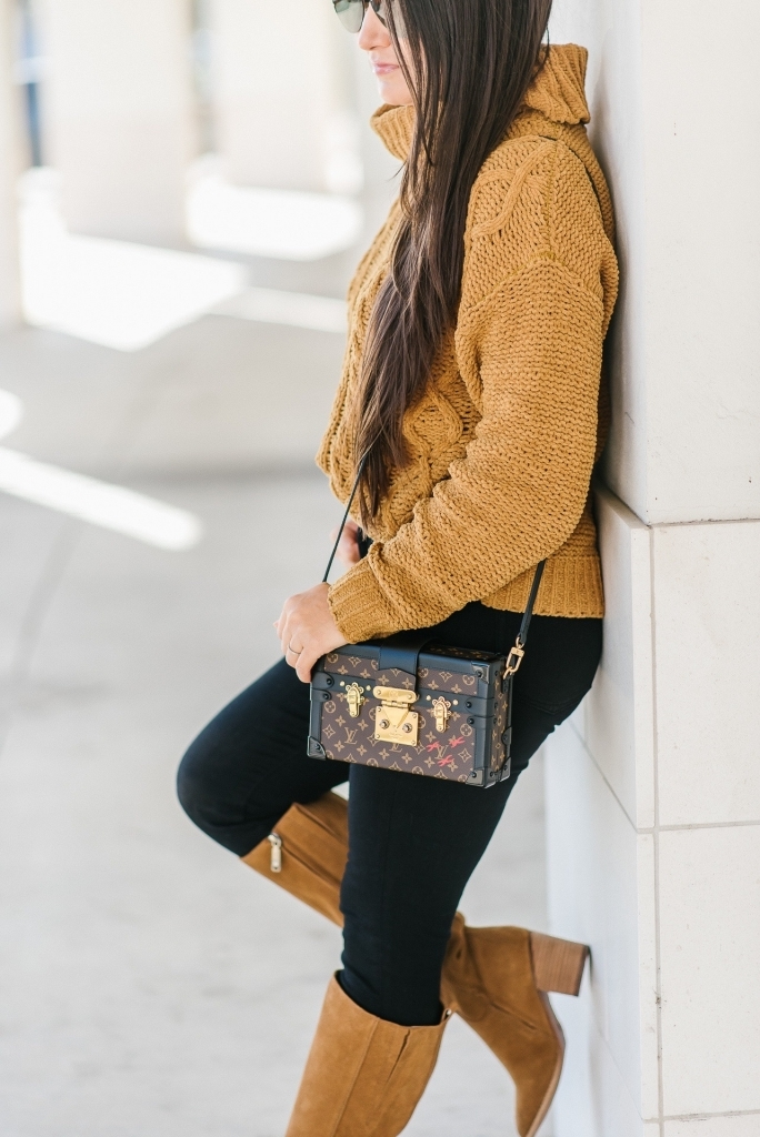 Luxury Handbag Collection and Review featured by top US fashion blog, LuxMommy: image of a woman wearing a Louis Vuitton petite malle