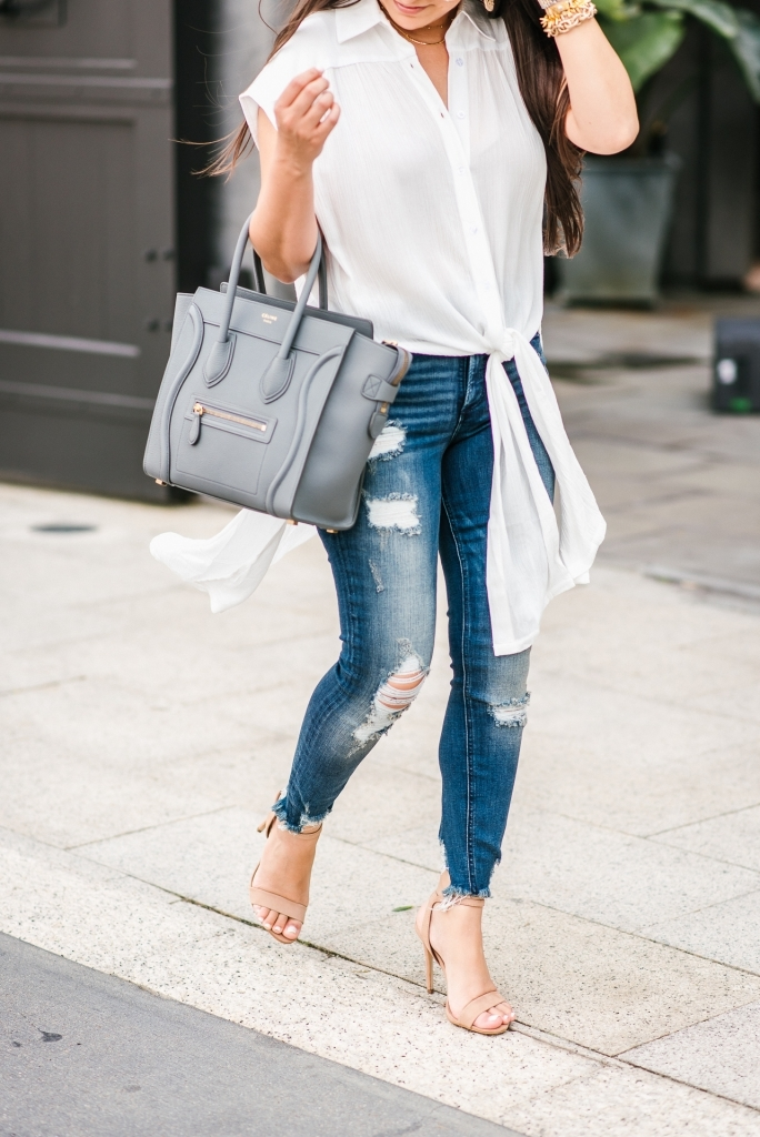 Luxury Handbag Collection and Review featured by top US fashion blog, LuxMommy: image of a woman wearing a Celine Luggage Micro Kohl