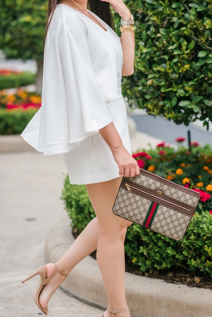 Luxury Handbag Collection and Review featured by top US fashion blog, LuxMommy: image of a woman wearing a Gucci Ophidia pouch