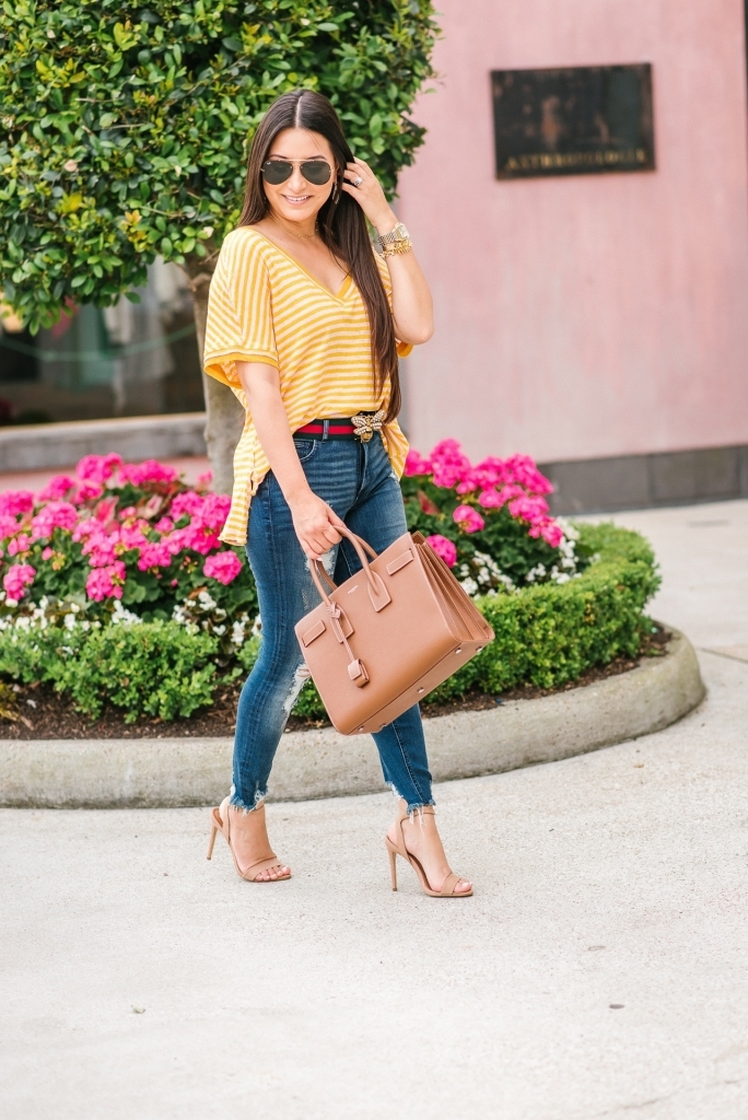 Luxury Handbag Collection and Review featured by top US fashion blog, LuxMommy: image of a woman wearing a Saint Laurent Sac De Jour