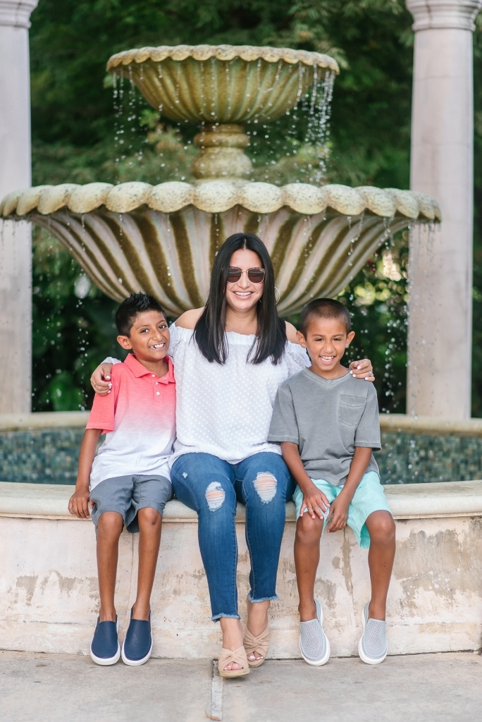 Back to School Style with Walmart by popular Texas fashion blog, Lux Mommy: image of a mom and her two boys sitting on the edge of a courtyard fountain.