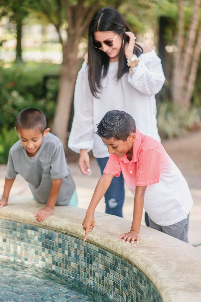 Back to School Style with Walmart by popular Texas fashion blog, Lux Mommy: image of a mom and her two boys looking in to a fountain.