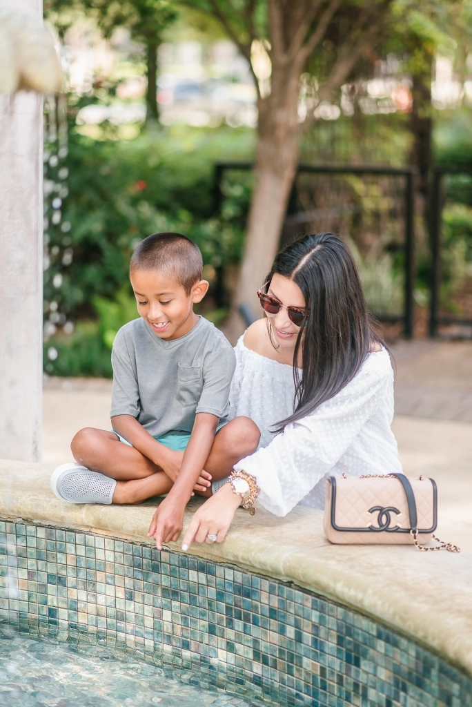 Back to School Style with Walmart by popular Texas fashion blog, Lux Mommy: image of a mom and son looking in to a courtyard fountain.