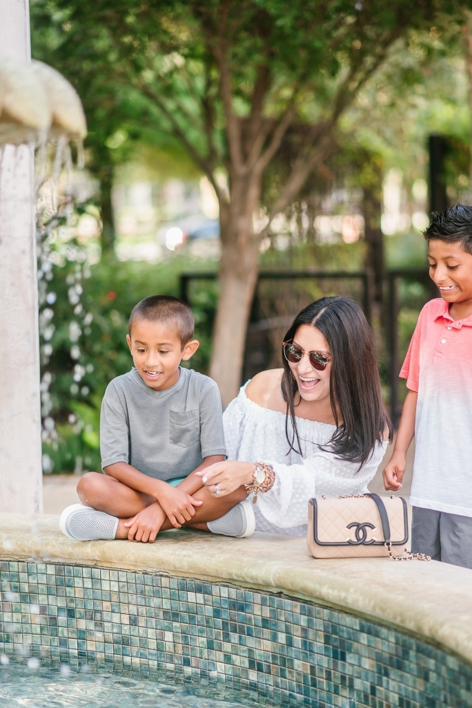 Back to School Style with Walmart by popular Texas fashion blog, Lux Mommy: image of a mom and her two boys looking in to a courtyard fountain.
